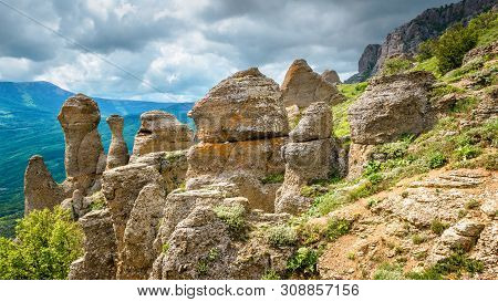 Bizarre stones of Demerdji mountain, Crimea, Russia. Scenic view of the Valley of Ghosts, landmark of Crimea. Beautiful landscape of Crimea in summer. Scenery of nature of Southern coast of Crimea. poster