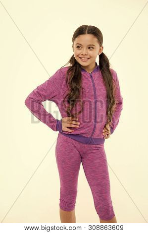 poster of Working out with long hair. Girl cute kid with long ponytails wear sportive costume isolated on white. Sport for girls. Guidance on working out with long hair. Deal with long hair while exercising.
