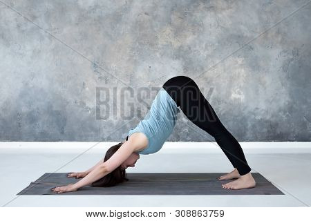 Woman Standing In Yoga Downward Facing Dog Pose, Adho Mukha Svanasana