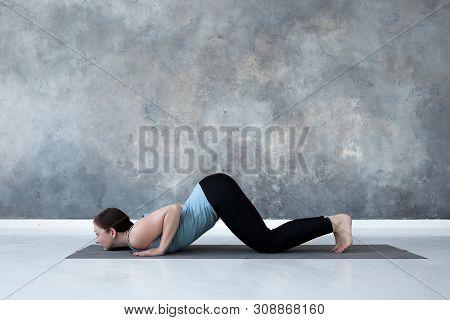 Woman Practicing Yoga, Doing Ashtanga Namaskara From Sun Salutation.