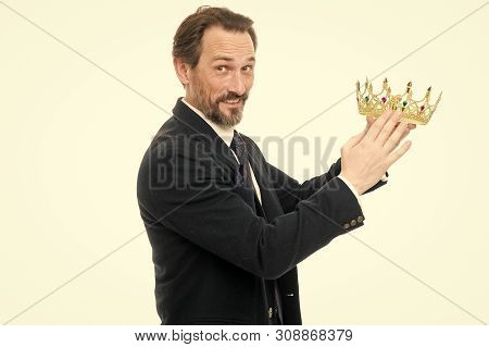 Become next king. Monarchy family traditions. King attribute. Man nature bearded guy in suit hold golden crown symbol of monarchy. Direct line to throne. Enormous privilege. Become king ceremony. poster
