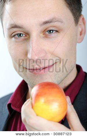Young man eating apple