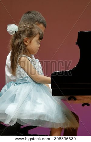 Japanese Brother And Sister Playing Piano On Stage (9 Years Old Boy And 4 Years Old Girl)