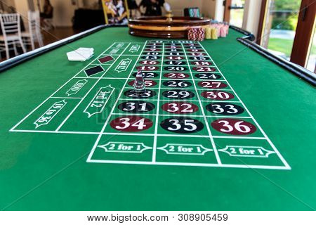Roulette Table Felt With Markings For Players To Place Their Wagers And Chances To Gamble A Win.