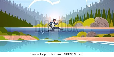 Brave Businesman Jumping Over River With Crocodiles Risk And Danger Optimism Determination Concept B