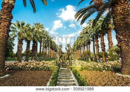 Two Black Men Statue Standing And Talking To Each Other In Public Park Called Kültürpark At Izmir, T