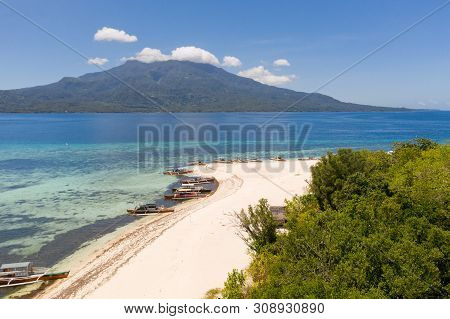 White Sandy Beach On The Island Of Mantigue, Philippines. View Of The Island Camiguin. White Sand Be