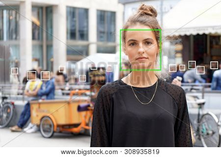 Young Woman Picked Out By Face Detection Or Facial Recognition Software - Several Other Faces Detect