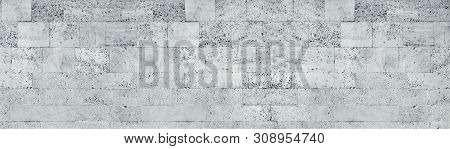 Tuff Stone Block Wall Wide Texture. Gray Rough Masonry Panorama. Long Grunge Background