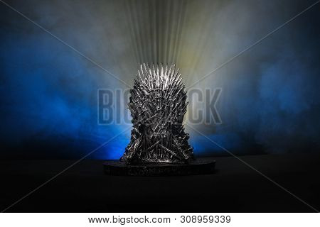 The Model Of Throne As In Game Of Throne At A Bright Blue Smoke Background