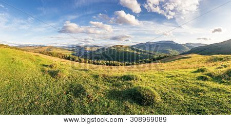 Panorama Of A Countryside In Mountains. Beautiful Early Autumn Landscape In Evening Light. Grassy Me