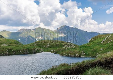 Alpine Glacier Capra Of Fagaras Mountains. Gorgeous Summer Landscape. Good Weather With Clouds On Th
