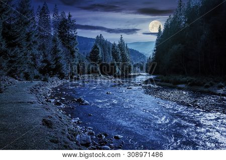 Mountain River Winding Through Forest At Night In Full Moon Light. Beautiful Nature Scenery In Autum