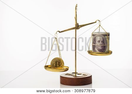 Bitcoin value increase trend. The coin outweighs the balance. On another bowl a stack of hundred dollar bills. White background - image poster