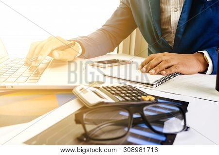 Business Accounting Plan Concept, Working On Desktop Laptop Computer With Calculator For Making Busi