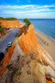 Aerial view on the beach Praia da Falesia Barranco das Belharucas with red rocks and golden sand. Region Faro, Algarve. Vacation in Portugal. Beautiful seascape. poster