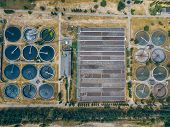 Modern wastewater treatment plant, top view from drone. poster
