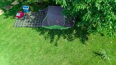 Aerial top view of campsite from above, tent and camping equipment under tree, family vacation in camp outdoors concept poster