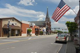 Coldwater, Oh, May 25, 2019, Small Town American Heartland Main Street With Cafe, Bank, Catholic Chu