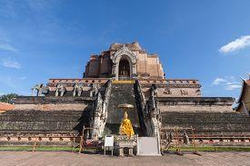 Pagoda And Buddha Statue At Wat Chedi Luang Temple In Chiang Mai Thailand