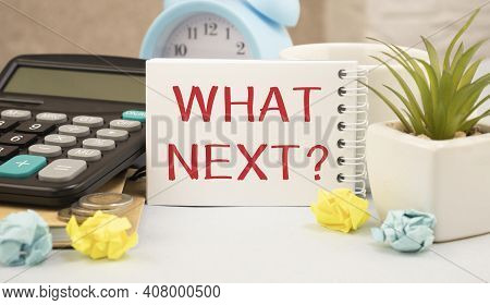 What's Next , The Phrase Is Written On Notepad, On A Office Desk. Business Concept, Strategy, Plan,