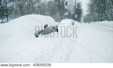 Moscow, Russia - 13 February 2021: Heavy Snowfall Snowfall In Moscow Bloked Parked Vehicles . The Ca
