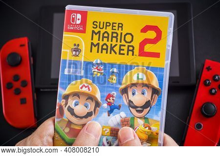 Tambov, Russian Federation - January 24, 2021 A Man Holding A Super Mario Maker 2 Video Game In Plas