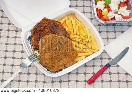 Food Delivery. Balkan Cuisine. Salad, French Fries And Pljeskavica - Grilled Dish Of Minced Meat,