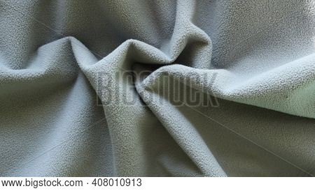 Crumpled Folds Of Gray Material With A Short Textured Pile, Curved Surface Of Dense Soft Fabric Of A
