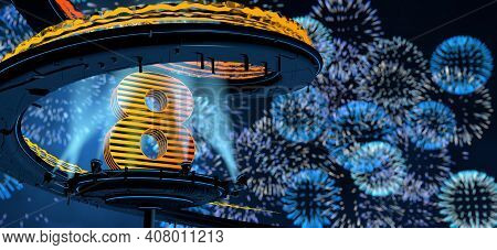 Number 8 Formed By A Yellow Structure On A Round Metal Platform Illuminated By 8 Reflectors Surround