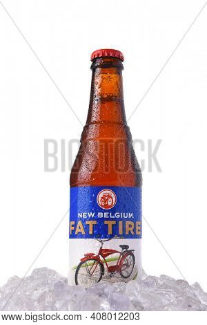 IRVINE, CALIFORNIA - MARCH 12, 2018: Fat Tire Amber Ale in ice. A bottle of Fat Tire Amber Ale from the New Belgium Brewing Company, of Fort Collins, Colorado.