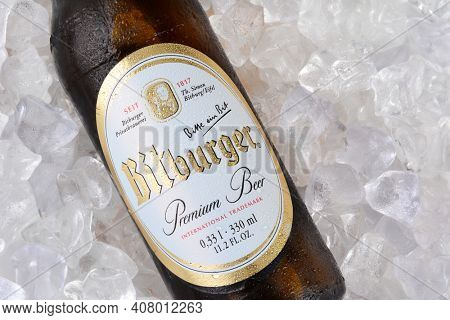 IRVINE, CA - JANUARY 11, 2015: A closeup of a bottle of Bitburger Beer on a bed of ice. Bitburger is a German family business with around  that in 2012 produced around 750 million litres of beer.