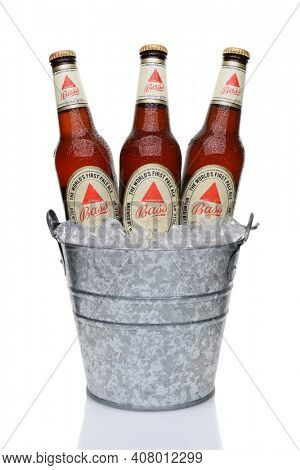 IRVINE, CA - MAY 28, 2014: Bass Pale Ale Bottles in ice bucket. The Bass Brewery was founded in 1777 by William Bass, in Trent, England is now owned by Anheuser-Busch InBev.