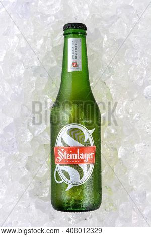IRVINE, CA - JANUARY 11, 2015: A full length bottle of Steinlager Classic on a bed of ice. The lager style beer has been produced by Lion Nathan since 1957 in Newmarket, New Zealand.