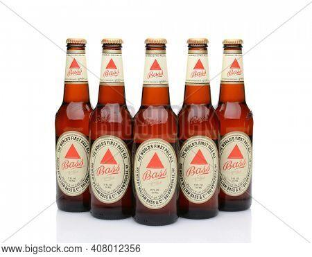 IRVINE, CA - MAY 25, 2014: Five bottles of Bass Ale on white. The Bass Brewery was founded in 1777 by William Bass, in Trent, England is now owned by Anheuser-Busch InBev.