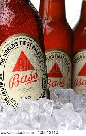 IRVINE, CA - MAY 30, 2014: Closeup 0f Bass Pale Ale bottles in ice. The Bass Brewery was founded in 1777 by William Bass, in Trent, England is now owned by Anheuser-Busch InBev.