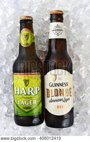 IRVINE, CA - JANUARY 11, 2015: A bottle of Harp Lager and Guinness Blonde on a bed of ice. Both lagers are made by the Guinness Brewing Company in Dublin, Ireland.