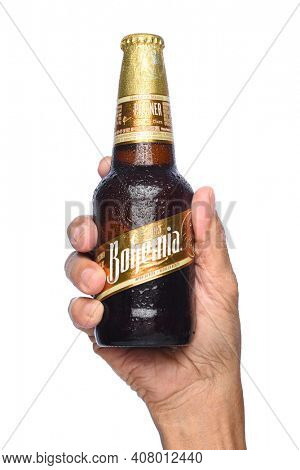 IRVINE, CALIFORNIA - APRIL 26, 2019: Closeup of a hand holding a bottle of Bohemia Beer. From Cerveceria Cuauhtemoc-Moctezuma, founded in 1890, now a subsidiary of Heineken International.