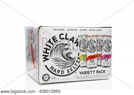 IRVINE, CALIFORNIA - 03 DEC 2019: A 12 can pack of White Claw Hard Seltzer on white with reflection.
