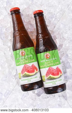 IRVINE, CA - JULY 17, 2017: New Belgium juicy Watermelon Lime Ale bottles on ice. A craft brewery located in Fort Collins, Colorado. It was opened in 1991 by Jeff Lebesch and Kim Jordan.