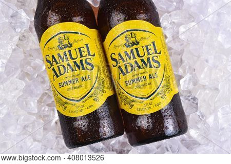 IRVINE, CALIFORNIA - 09 AUG 2020: Closeup of two bottes of Samuel Adams Summer Ale on a bed of ice.