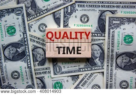 Quality Time Symbol. Wooden Blocks With Words 'quality Time'. Beautiful Background From Dollar Bills