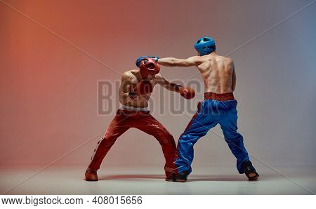 Jab Of Fighting Males In Boxing Gloves With Bare Fit Torsos In Red Light In Studio, Martial Arts, Mi