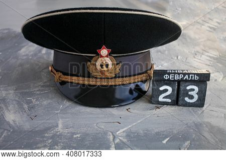 Wooden Calendar With The Date Of February 23, And  Headgear Officer Of The Navy Of The Ussr And Russ