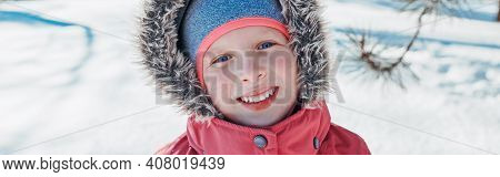 Cute Adorable Happy Caucasian Smiling Girl In Pink Jacket With Fur Hood During Cold Winter Day. Kids