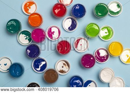 Acrylic Paints Of Various Colors For Drawing Are Open On The Table. Bright Colorful Background From