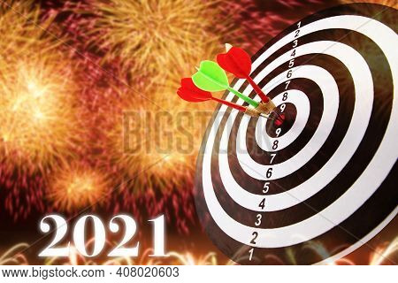2021 With Target And Goal Concept. Close Up Shot Of The Dart Arrow Hit On Bullseye, Red Dart Arrow H