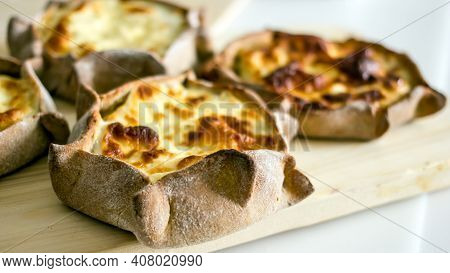 National Rye Dough Pies With Potato Filling. National Karelian Food Wicket Close-up On On The Baking