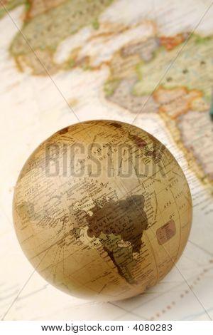 Globe Over Map