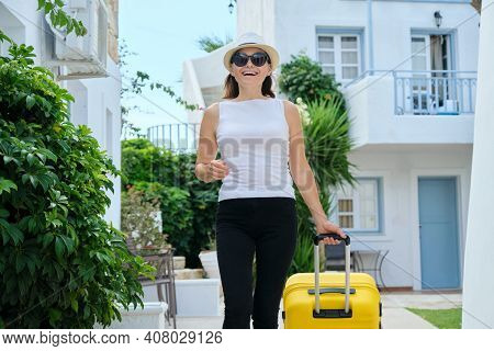Woman In Hat Sunglasses With Suitcase Walking Outdoor Through Territory Of Sea Picturesque Resort Sp